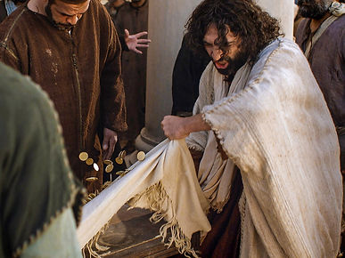Jesus turning over tables in the temple.