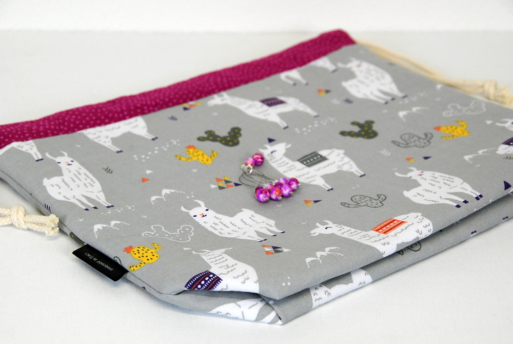 Drawstring bags with llamas and pink stitch markers