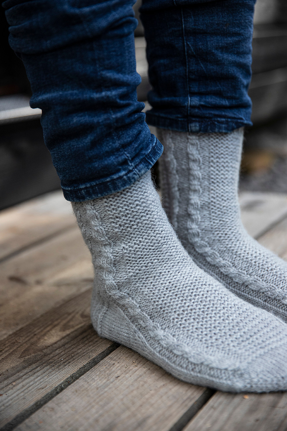 Juhani's socks feature a garter stitch panel flanked by narrow cables.