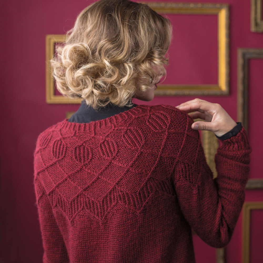 Margaret Holzmann's Dover is knit from the bottom up and features a traveling stitch pattern on the yoke (Art of Circular Yokes, Interweave 2019).