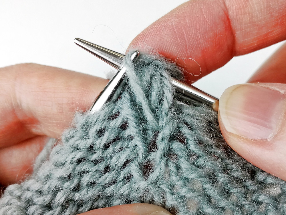 Step 5. Pass the loops over the purled stitch.