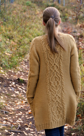 The Comeback Cardigan is a return to my first love in knitting: epic cables. This top-down, aran-weight cardigan features raglan sleeves, a scoop neck, wide cable details on the back, sleeves, and deep set-in pockets.