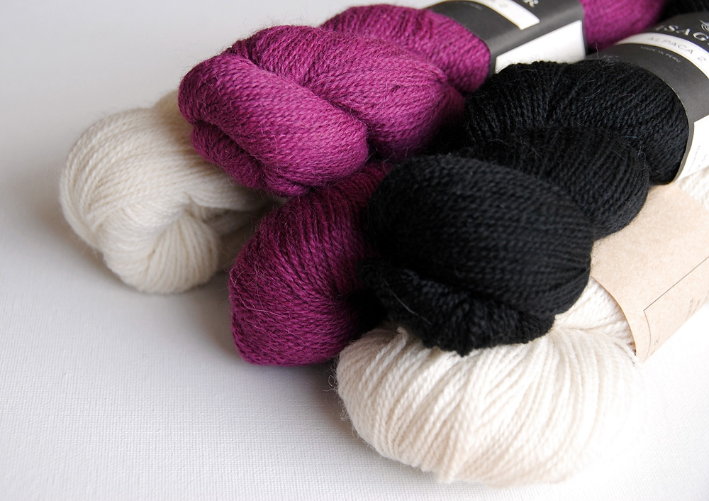 Isager Alpaca 2 in natural, black, and fuchsia