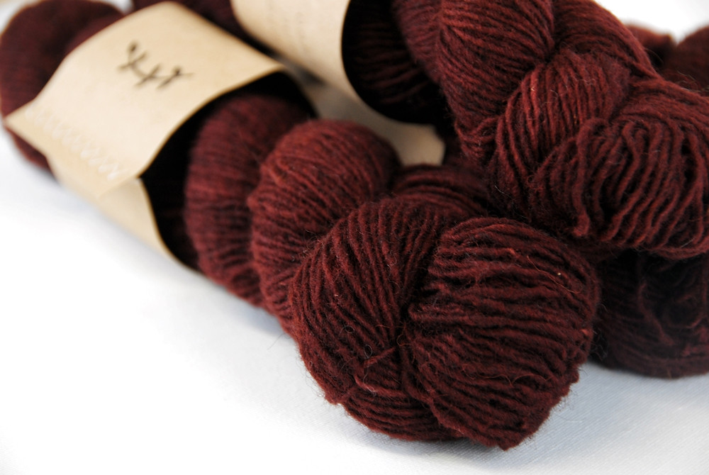 Lichen and Lace Rustic Heather Sport in the colorway Beet.