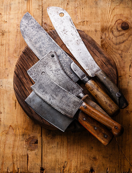 Butcher Meat cleavers on oak block