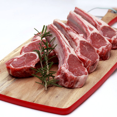 Raw lamb cutlets with rosemary on choppi