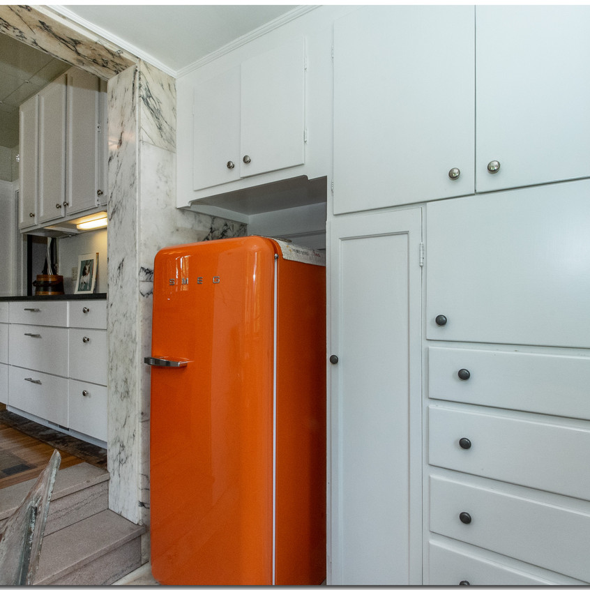 eating area cabinets & fridge