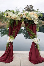 burgundy fabric alter arch.jpg
