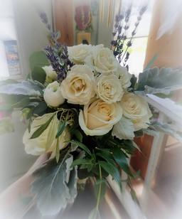 white roses, eucalyptus, dusty miller, lavender