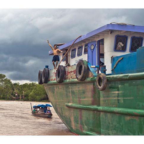 Cargo Boat Captain, Near Vinh Long, Vietnam