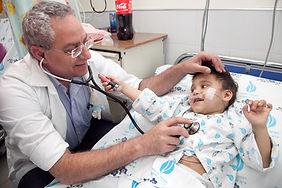 dr Sasson and Romanian child.jpg