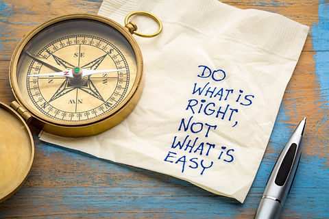 """Compass with napkin that reads """"Do what is right, not what is easy"""""""