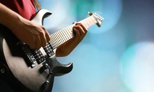 man-practicing-electric-guitar.jpg