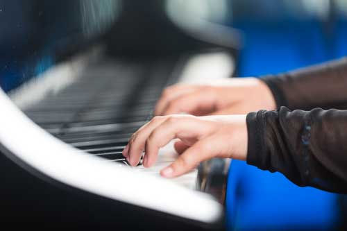student-practicing-piano.jpg