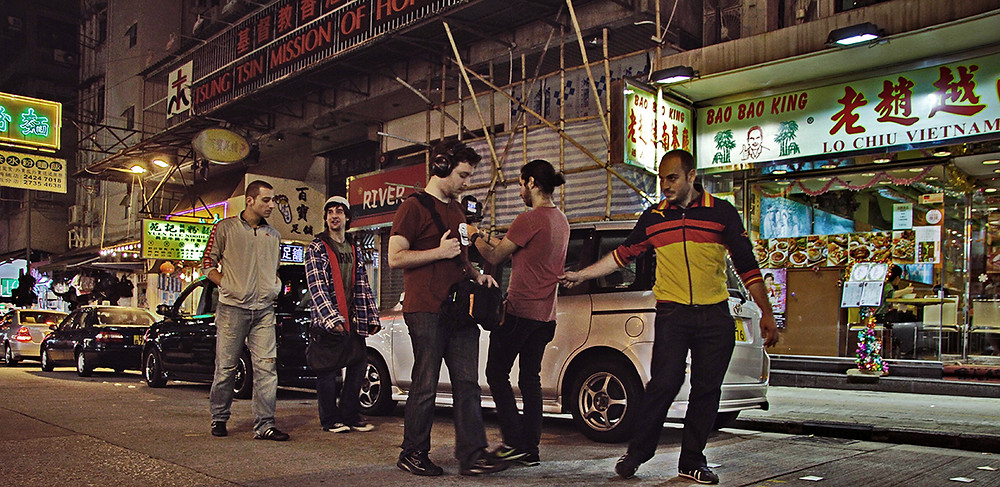 A no budget film crew shoot on the streets of Hong Kong in Prayers to the Gods of Guerrilla Filmmaking