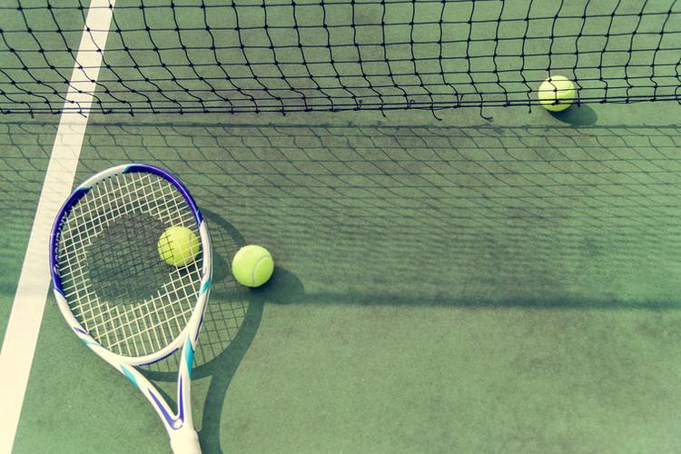 bigstock-Tennis-balls-on-a-tennis-court-241747996.jpg