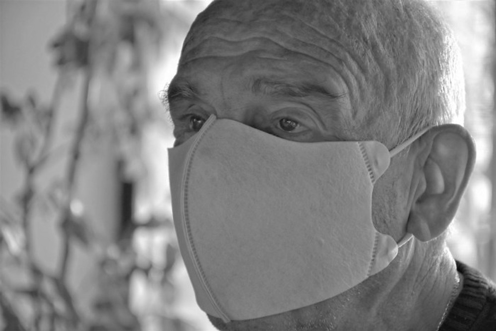 Old Man Wearing A Mask to protect against corona virus or covid-19