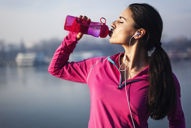 woman drinking water breath and beats