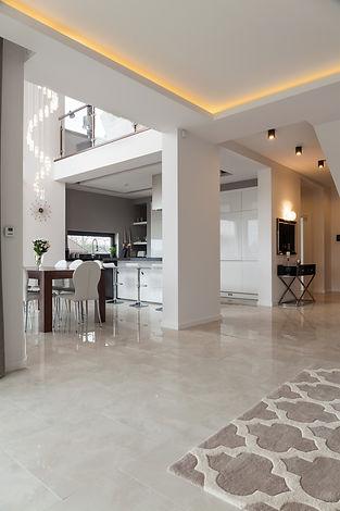 Wide corridor with marble floor in big h