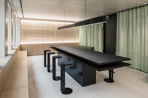 interior design, meeting room, green curtain, beige carpet, black furniture