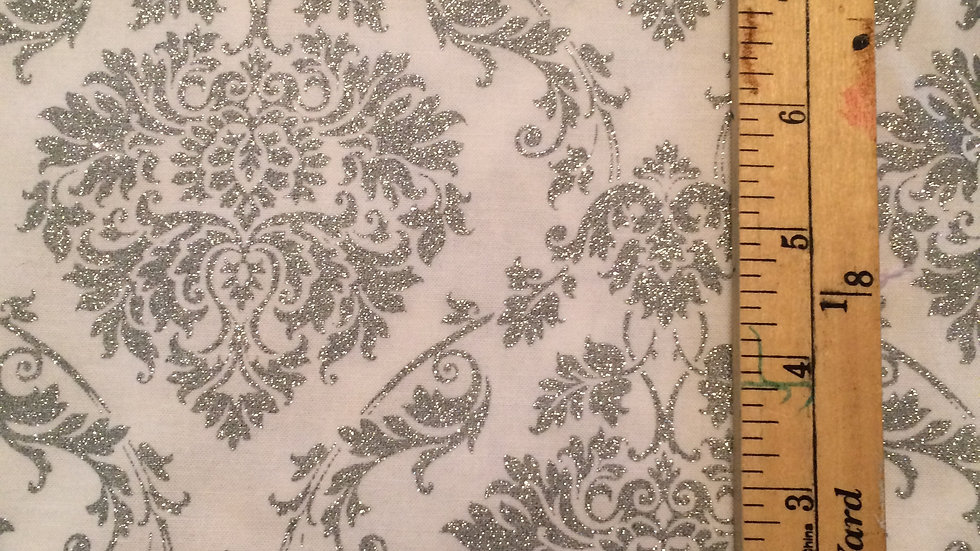 Silver / Gray glittery pattern on white fabric