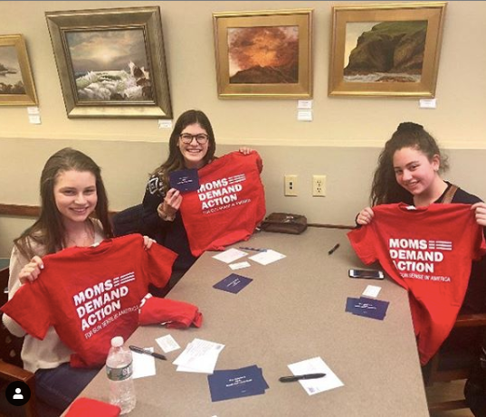 HVSU members writing postcards with Moms Demand Action