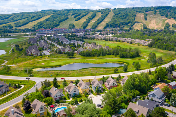 Blue View Aerial golf village mountain.j