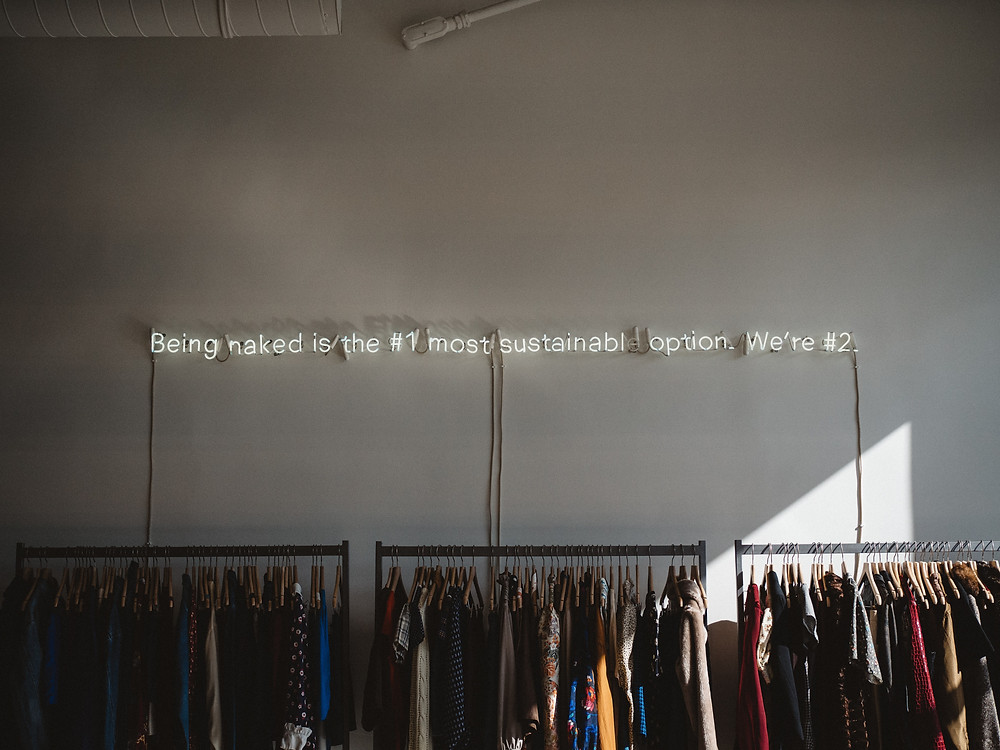 """Clothes rail with """"being naked is the #1 most sutainable option. we're #2"""""""