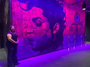 Vanessa Drews next to the Prince mural inside the Fillmore Minneapolis