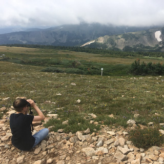Centaurus High School student watching the clouds roll in at Niwot Ridge