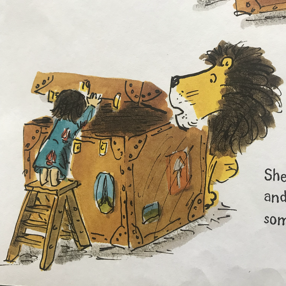 A girl and a lion peak inside a very large box. What is inside?