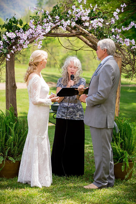 Beth & Hank Bruno with wedding officiant