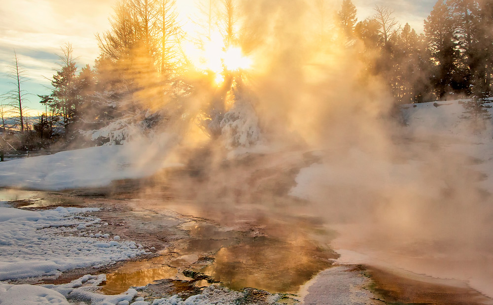 Steam rising from hot springs and geysers at Mammoth Hot Springs in Yellowstone National Park, Montana.