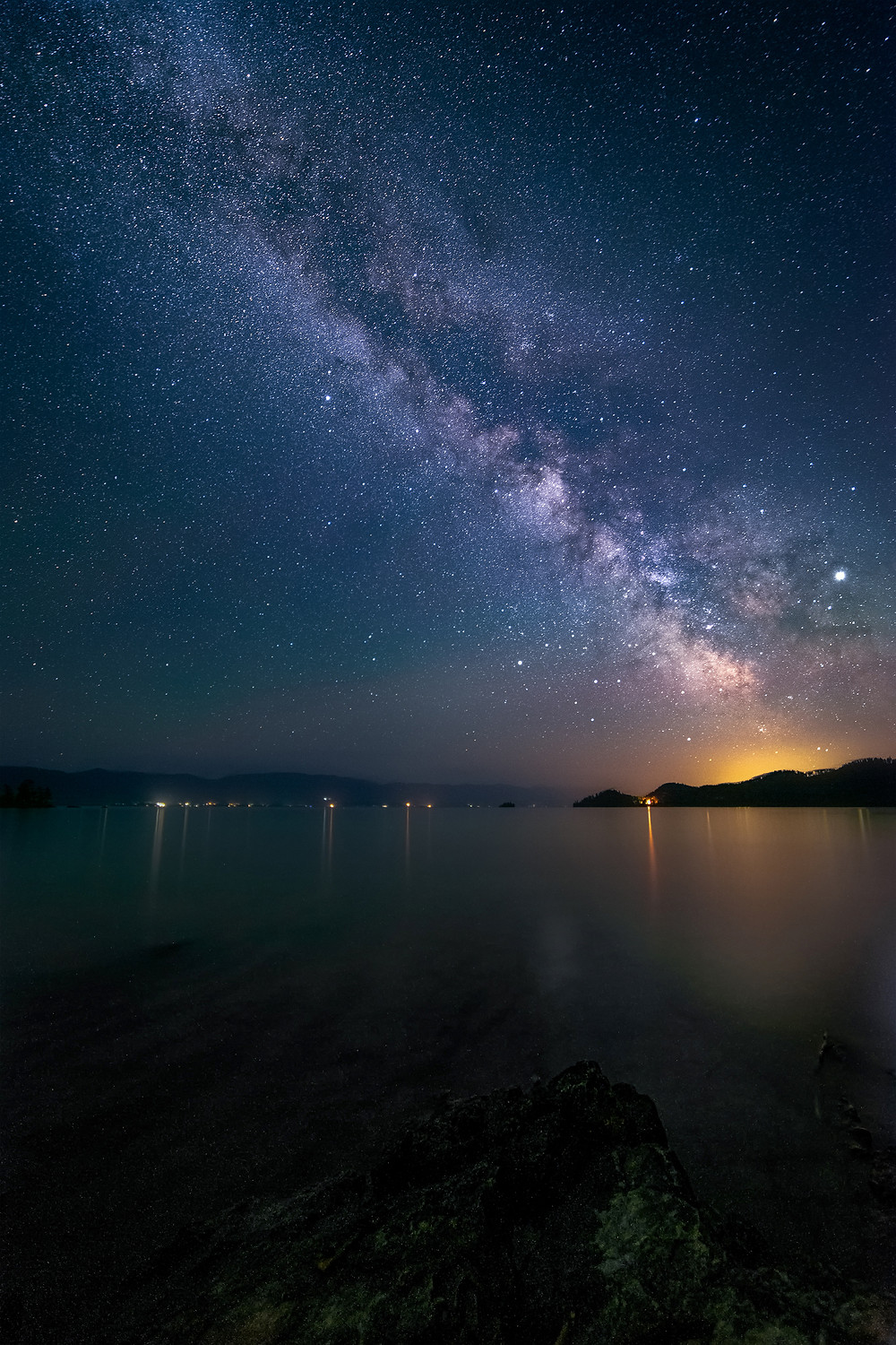 Milky Way in the night sky above Flathead Lake from West Shore State Park, Montana.