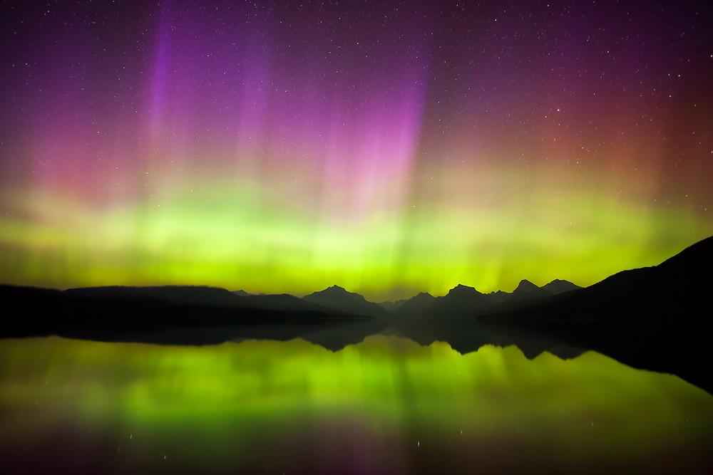 Northern Lights shining above Lake McDonald, Glacier National Park, Montana.