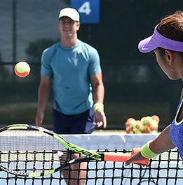 tennis coach teaching.jpeg