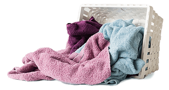 pile of towels out of a laundry basket
