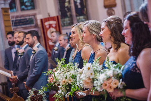 Bridesmiads in Church holding Spring Wildflower Foliage Bouquets