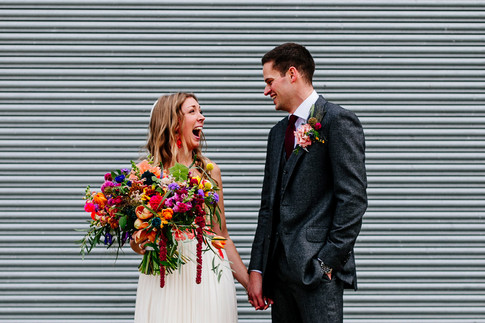 Bride and Groom Photo with Vibrant Wildflowers