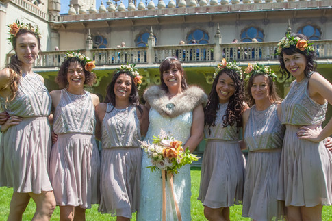 Brunette Bride Holding Hand Tied Wildflower Wedding Bouquet with Pink Roses with Bridesmaids wearing Floral Crown Hairstyles