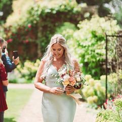 Mint bridesmaids dress, peachy flowers, bridesmaids flowers