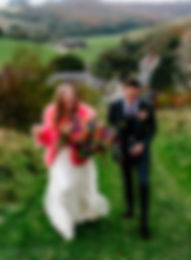 alternative brideat Upwaltham barns, autumnal wedidng flowers from sussexflorist, bright and colourful wild bouquet, oversized boquet.