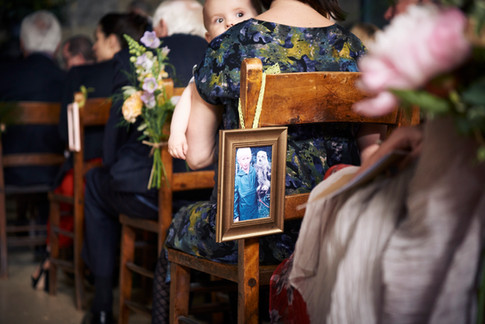 Antique Gold Frame Wedding Decoration on Wooden Chairs