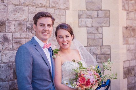 Bride and Groom photo holding Pink Spring Bouquet