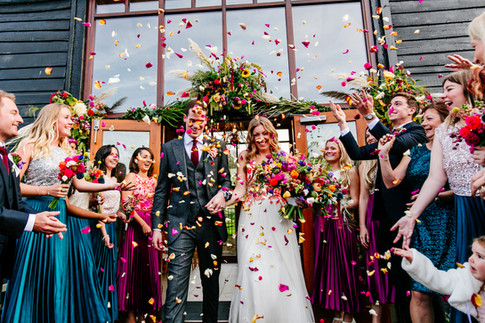 Bride and Groom Photo with Vibrant Wildflower Foliage Outdoor Wedding Decoration