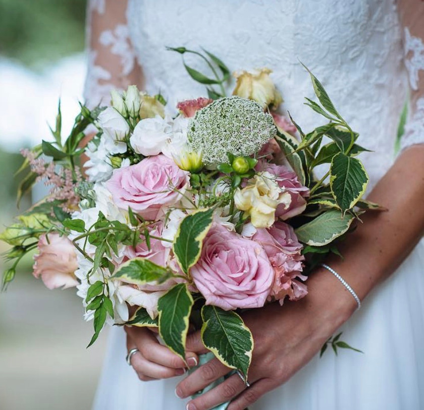 Dusky pink roses and white summer flowers combined in this garden inspired style luxury wedding bouquet.