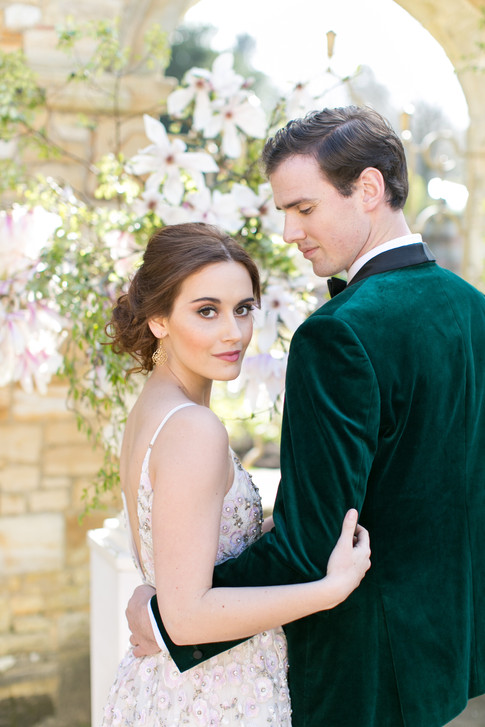 Bride in Romantic Floral Wedding Dress and Groom in Velvet Jacket  by Magnolia Flower Outdoor Wedding Decorations