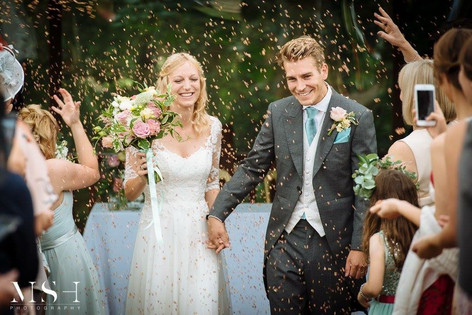 Bride and Groom under Confetti Small Hand Tied Wedding Bouquet with Pink Roses