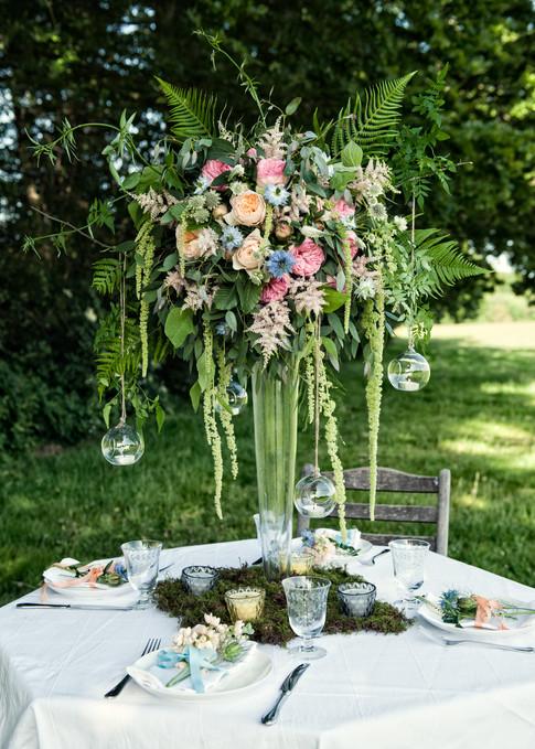 Pink Wildflower Centrepiece in Tall Glass Vase