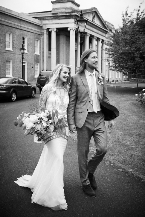 Black and White Photo of Groom and Bride holding Hand Tied Bouquet